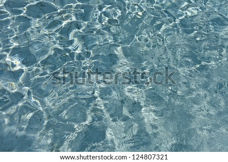 Most beautiful clear pool water reflecting in the sun #124807321