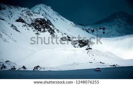 Expedition to the North Pole, big powerful jeep in the snowy, majestic great mountaing, amazing winter landscape, active extreme life, Iceland #1248076255