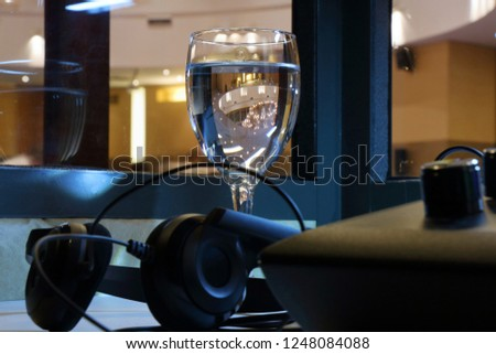 A glass of water for the interpreter in a special cabin of simultaneous translation Royalty-Free Stock Photo #1248084088