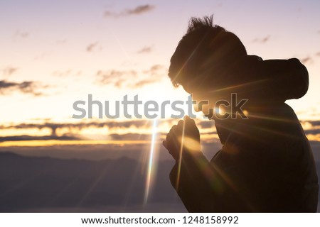 Silhouette of christian man hand praying,spirituality and religion,man praying to god. Christianity concept.  #1248158992