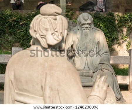 QINGDAO, CHINA - 23 OCTOBER 2018: Confucius in discussion with Lao Tze by Tai Qing Gong at Laoshan near Qingdao China #1248238096