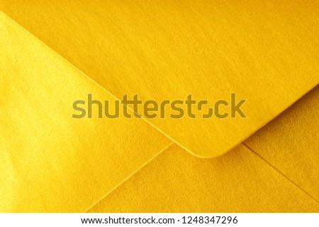 Abstract background in gold color. Detail envelope close up. Copy space   #1248347296