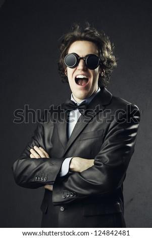 Portrait of an elegant young man bizarre screaming #124842481