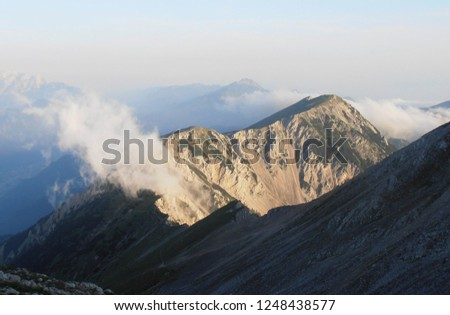 Mountaing ridge in morning sun #1248438577