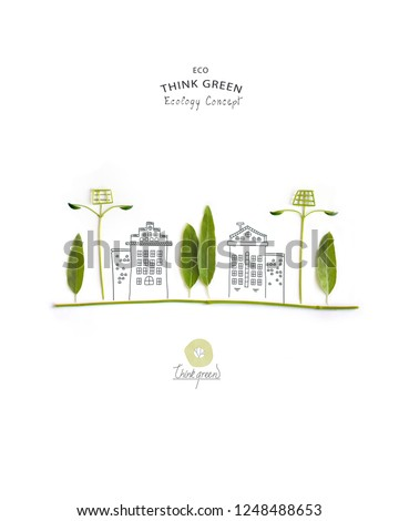 Environmentally friendly planet. Trees and solar street lights, made of green leaves with hand drawn sketches of a city houses. Minimal nature concept.Think Green. Ecology Concept.Flat lay.Top view. #1248488653