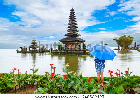 A girl under the umbrella, Ulun Danu Bratan Temple, Bali, Indonesia #1248569197