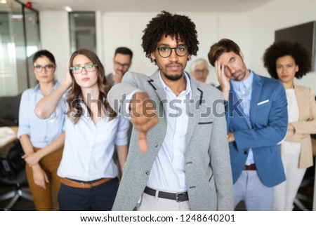 Group of unsuccessful business people and badly managed company leads to unhappiness #1248640201