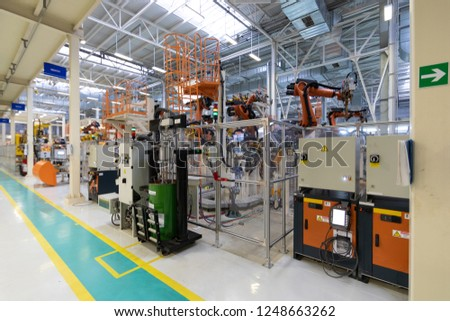 Car manufacturing plant. Automotive shop. The Assembly line for manufacturing cars. #1248663262