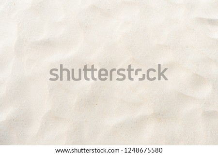 Close-up Fine beach sand in the summer sun as background #1248675580
