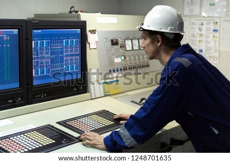 Young engineer in a cargo control room of a oil tanker. #1248701635