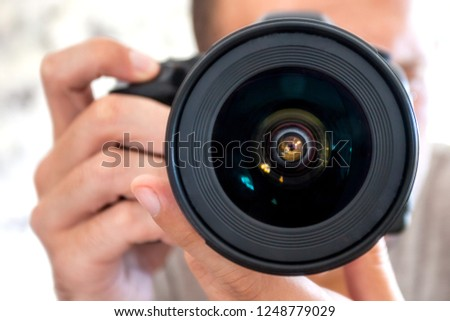 close-up photographer with a large professional lens #1248779029