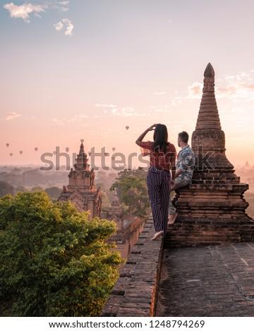 couple sunrise Bagan, men woman sunset Bagan .old city of Bagan Myanmar, Pagan Burma Asia old ruins Pagodas and Temples #1248794269