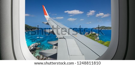View from airplane. Flight window. Vacation destinations. Tropical beach.  Travel concept. #1248811810