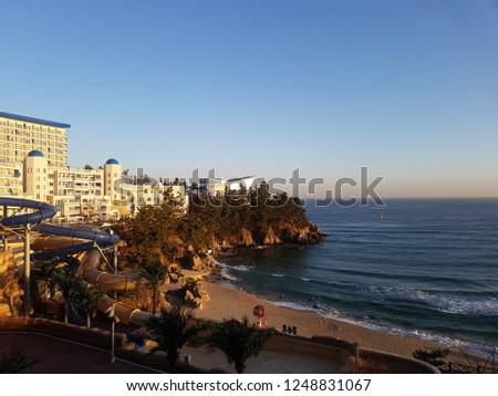 sea with resort hotel #1248831067