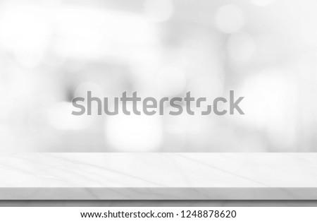 Empty white marble over blur background, for your photo montage or product display, Space for placing items on the table, product and food display. #1248878620