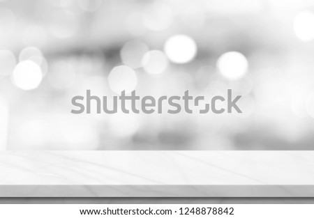 Empty white marble over blur background, for your photo montage or product display, Space for placing items on the table, product and food display. #1248878842