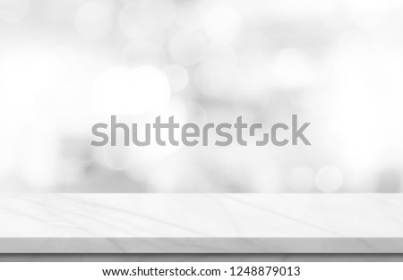 Empty white marble over blur background, for your photo montage or product display, Space for placing items on the table, product and food display. #1248879013