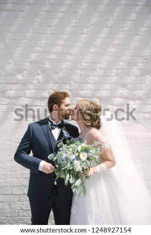 Bride and groom kiss #1248927154