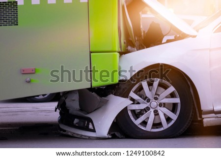 Car and bus accident, bumper to bumper #1249100842