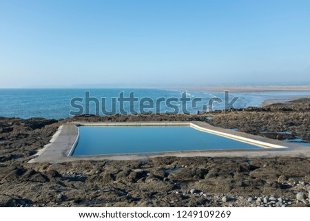 Westward Ho! Swimming pool outdoors sea ocean sky blue rocks rock pools day landscape Royalty-Free Stock Photo #1249109269