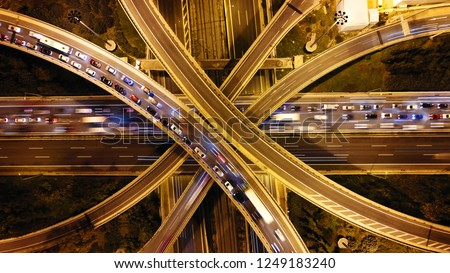 Aerial drone slow shutter night shot of urban elevated toll ring road junction and interchange overpass passing through National Road and Attiki odos, Attica, Greece