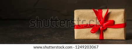 Gift Box, Ribbon - Kraft Paper  (dark background). top view, copy spac #1249203067