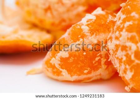 Peeled mandarin oranges on white background #1249231183