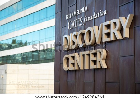 "Seattle, Washington / USA - December 3 2018: ""Bill and Melinda Gates Foundation Discovery Center"" sign on the exterior of the philanthropic headquarters building, with space for text on the left #1249284361"