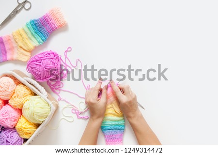 Colored balls of yarn. View from above. Rainbow colors. All colors. Yarn for knitting. Skeins of yarn. #1249314472