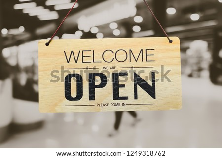 A business sign that says 'Open' on cafe or restaurant hang on door at entrance. Vintage color tone style. #1249318762