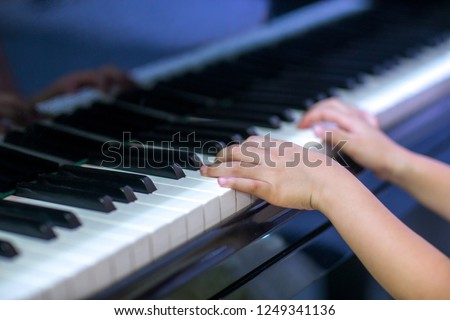 Hands of kid on piano keyboard in wedding ceremony #1249341136