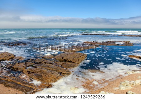 After the storm is over, cold Atlantic ocean at low tide on the Namibian Skeleton coast. #1249529236