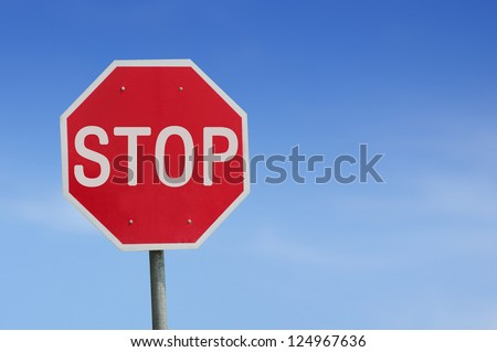 Stop sign blue sky background. Thailand Language.