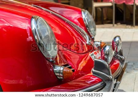 SAALBACH-HINTERGLEMM, AUSTRIA - JUNE 21 2018: Red Porsche 356 oldsmobile vintage veteran car detail on June 21, 2018 in Saalbach-Hinterglemm, Austria. #1249687057