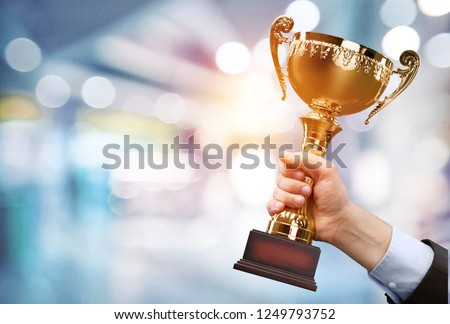 Champion golden trophy for winner background. Success and achievement concept. Sport and cup award theme. #1249793752