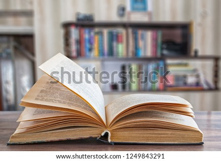 expanded book, blurred background bookshelf #1249843291