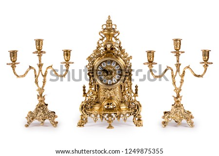 Vintage gold watch with candelabra on white background #1249875355
