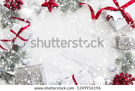 Christmas silver and red gifts and ornaments on white marble background top view. Merry Christmas greeting card, frame. Winter xmas holiday theme. Noel. Happy New Year. Flat lay #1249956196