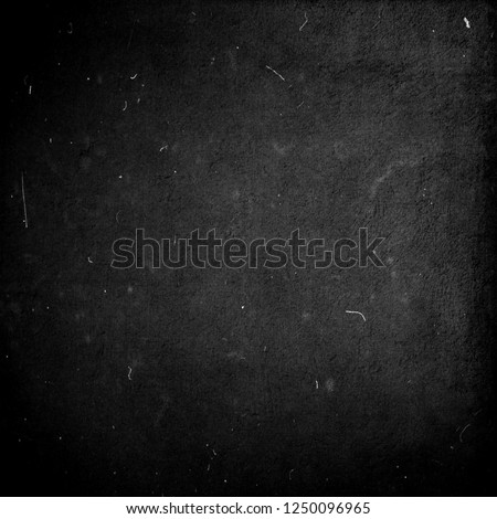 Black scratched grunge background, distressed texutre with frame, old film effect #1250096965
