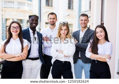 Portrait Of mixed race Business Team Outside of Office #1250182624