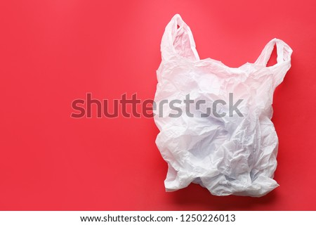 Clear disposable plastic bag on color background. Space for text #1250226013