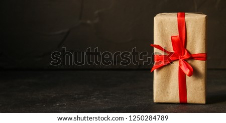 Gift Box, Ribbon - Kraft Paper  (dark background). top view, copy spac #1250284789