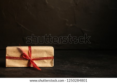 Gift Box, Ribbon - Kraft Paper  (dark background). top view, copy spac #1250284801