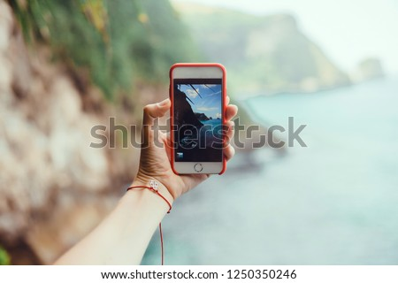 Woman make photo on smartphone, using phone in hand, travel blogger, amazing background, island nature, cell, video, Close up of women's hands holding cell telephone with blank copy space screen