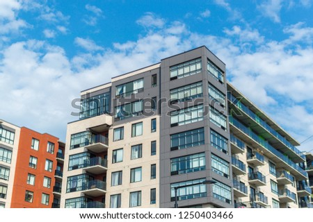 Modern condo buildings with huge windows in Montreal, Canada.  #1250403466