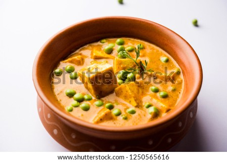 matar paneer curry recipe made using cottage cheese with green peas, served in a bowl. selective focus #1250565616