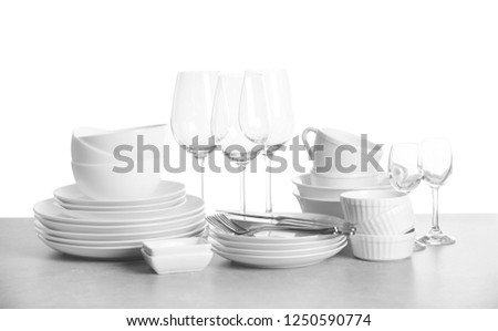 Set of clean dishes on white background #1250590774