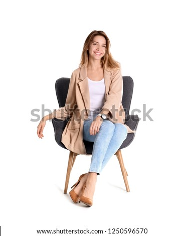 Young woman sitting in armchair on white background #1250596570