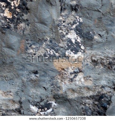 Abstract dirty stained grunge background. Wall background with color plaster. Modern art texture. Artistic backdrop with repetitive elements #1250657338