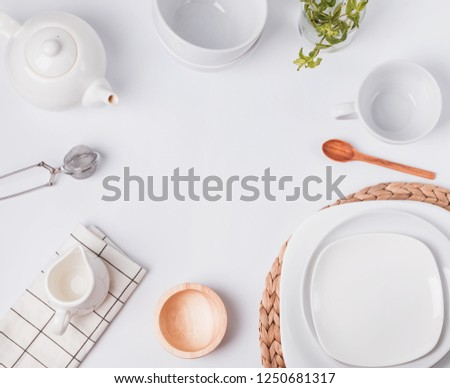 Different tableware and dishes on the white background, top view. Kitchen accessories flat lay. #1250681317